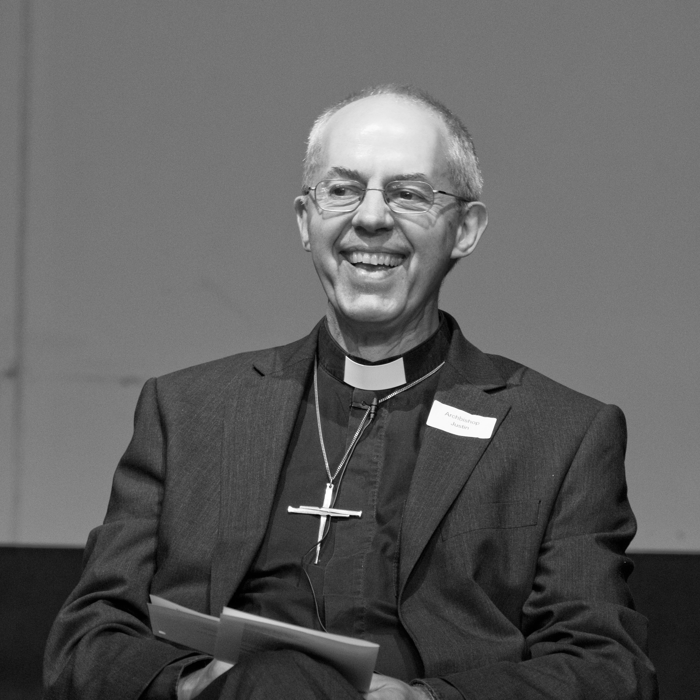 Justin Welby laughing on stage in Bristol