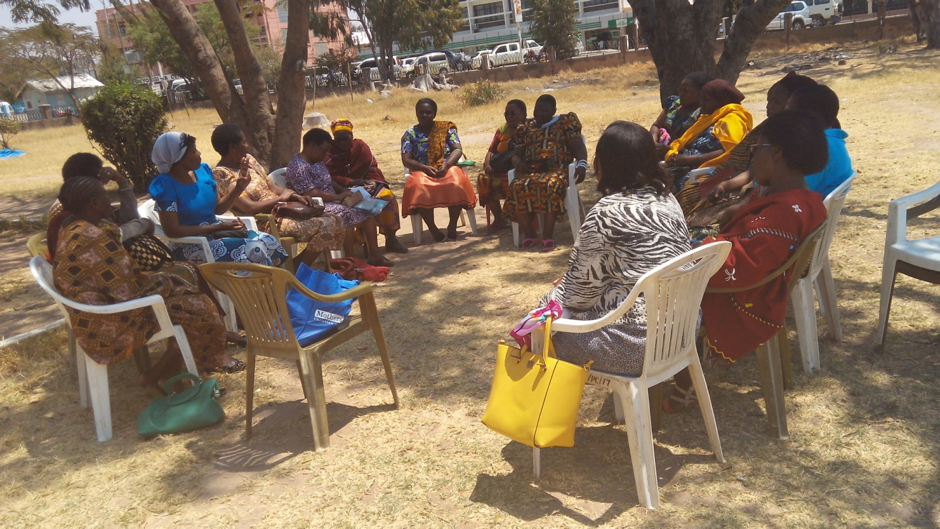 Women meeting to plan and organise their savings group, Tanzania.
