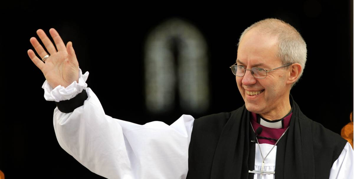 Justin Welby smiling and waving outside St Paul's Cathedral London