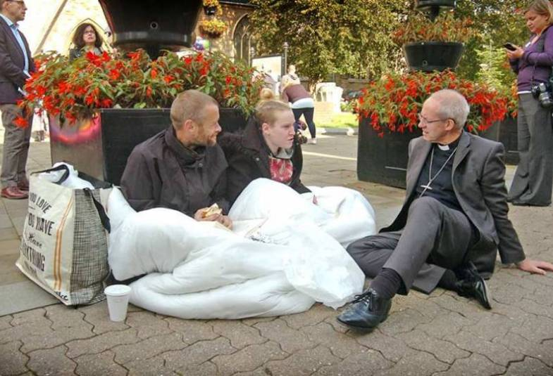 Archbishop Justin Welby with homeless people