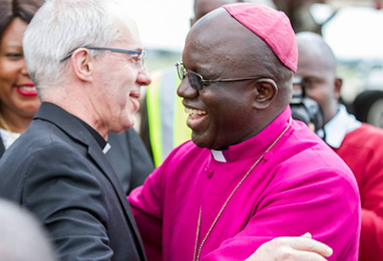 The Archbishop of Central Africa, Albert Chama, welcomes the Archbishop Justin at Lusaka's Kenneth Kaunda International Airport.