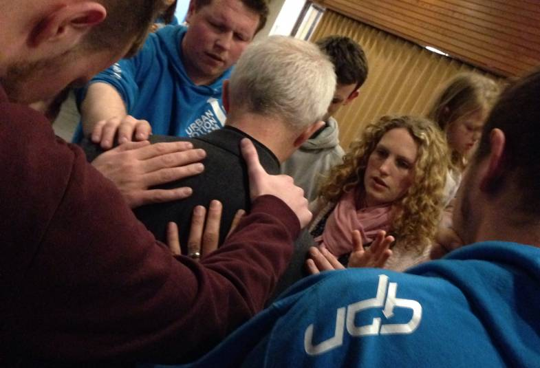 Archbishop Justin is prayed for by youthworkers in Birmingham, February 2015