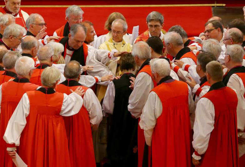 Bishops lay hands on Bishop Rachel during the service.