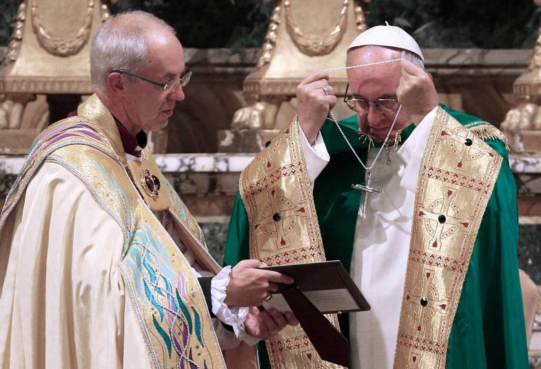 Justin Welby gives Pope Francis the cross of nails