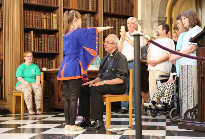A young girl blesses Archbishop Justin Welby after performing a dance