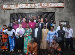 Justin Whelky with parishioners outside their church in the Congo