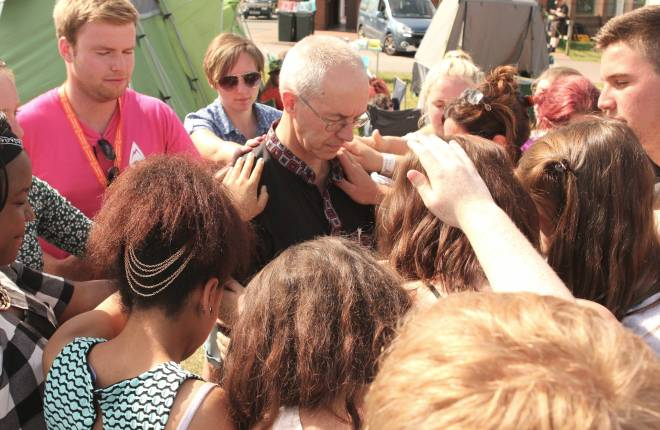 Young people praying for Archbishop Justin at Soul Survivor festival, summer 2014