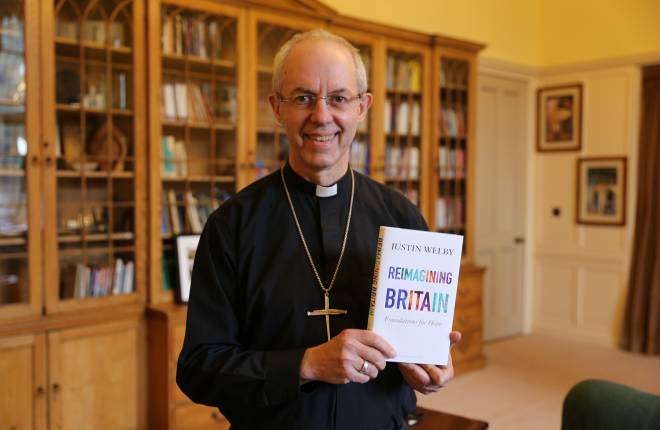 Justin Welby holding a copy of Reimagining Britain